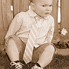 """my little guy 'bonked his bean' (graff lingo for """"hit his head"""") this morning awfully hard on the toybox.  he got over it very quickly but i was thinking that the black and blue spot on his forehead might not look too well for his birthday on sunday. so--i raced to dress him in his birthday portrait outfit and urged him to pose for me.  it was a struggle for us both but i think i got a couple of cute ones. (thanks john for offering feedback and helping me to pick these out of the album.)   happy early birthday my love.  sorry-but momma is probably going to dress you up for a few years to come--until you are able to put up a fight! more here: http://graffs.smugmug.com/gallery/5253917_FWefQ#319560566_ux7Uq"""